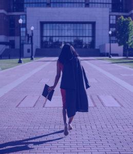 Girl walking towards a building