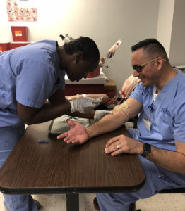 Medical assistant practicing phlebotomy